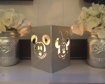Mickey and minnie face candle holder