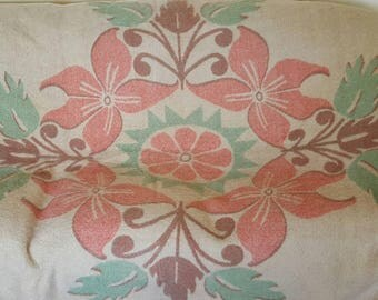 "Beautiful mid-century wool  blanket floral design in pastels pink peach and green . Measures 82"" x 68"""