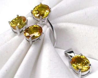 Wedding ring yellow sapphire ring silver sterling earring and pendant.