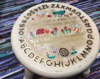 Childrens stool, upcycled with numbers, alpherbet and quote with nursery rhymes characters. English. UK