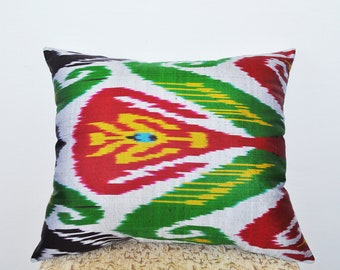 Juicy ikat pillow red-orange-yellow shades. Red ikat pillows, White ikat pillows
