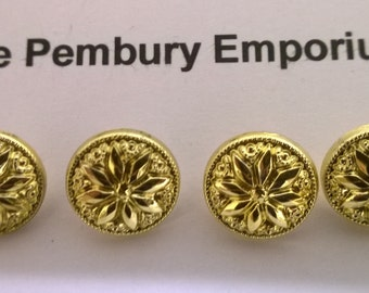 Buttons. Set of Four Gold Coloured Plastic Buttons with Flower / Star Design