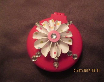 Compact mirror with pop up brush