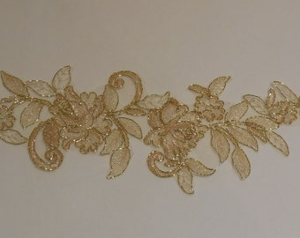 a large piece of gold floral lace applique with gold cords / lace tulle motif is for sale . sold by piece