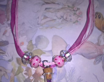 HALF PRICE SALE!! tiny bottle of secrets pink organza waxed necklace!
