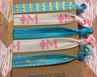 Show your Phi Mu Love with these Elastics! Set of 5