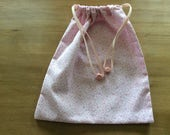 Teddy bear drawstring bag  pink and white pyjama bag featuring a pink and white appliqu bear diaper bag with pink wooden bead detail