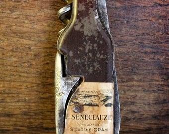 Vintage advertising knife bottle opener, corkscrew.