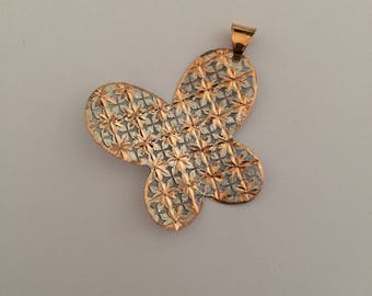 Butterfly shaped pendant in white and rose 18k gold.