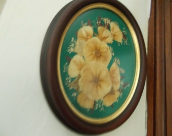 vintage shabby chic wooden oval frame with pretty dried flower arraignment