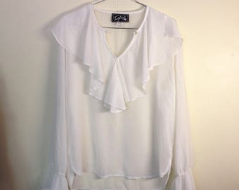 Sheer white frilly long-sleeved top
