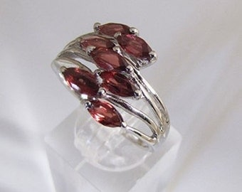 TRENDY Sterling Silver and seven garnets ring