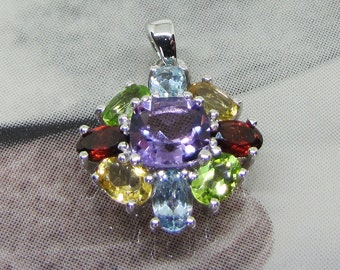 Multi Gemstone (GEMS) and silver pendant. 25% with code: SOLD17