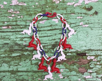 1950's Vintage bracelet with red and white celluloid circus Seals - red, white and blue plastic chain