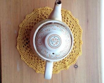 Handmade crocheted yellow round lace doily