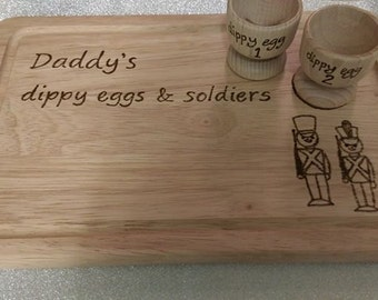 Personalised boiled eggs and soldiers board and cups.
