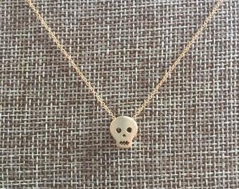Tiny gold skull necklace