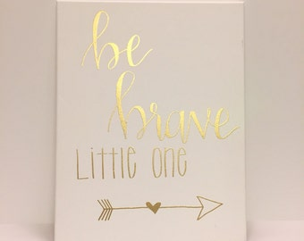 Be Brave Little One - Hand lettered and gold embossed, this canvas sign is perfect for any nursery or child's room. Makes a great gift too!