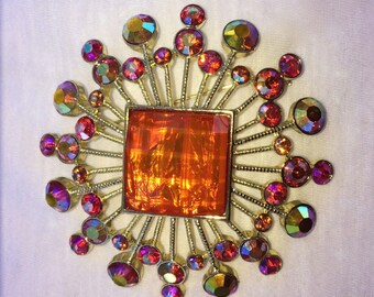 Vintage sun design brooch