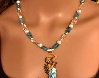 blue Glow in dark mermaid necklace 18 &3/4 inches