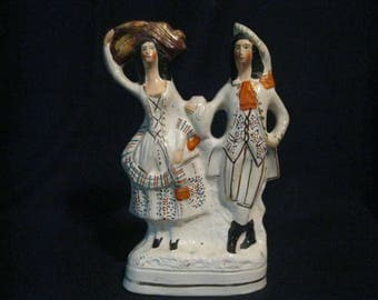 "Staffordshire ""Harvest Couple"" flat back figurine"