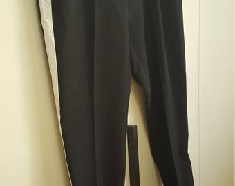 Black pants with white stripe on side
