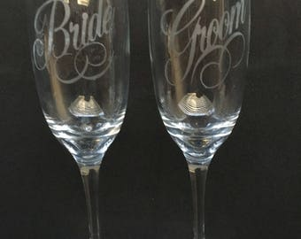 Bride & Groom Etched Champagne flutes.