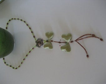 Green-duo butterfly. Necklace-pendant duo butterflies green pistachio.