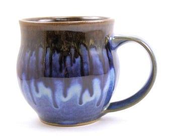 handmade mug. ceramic mug. large pottery mug. flowing deep blue glaze. handmade in ithaca. under the tree.