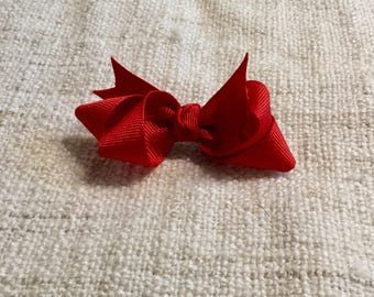 Red double loop bow.