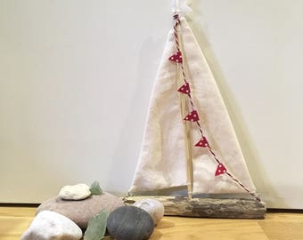 Hand Crafted, reclaimed driftwood Boat with rustic canvas sales, inspire by local beach and seaside.