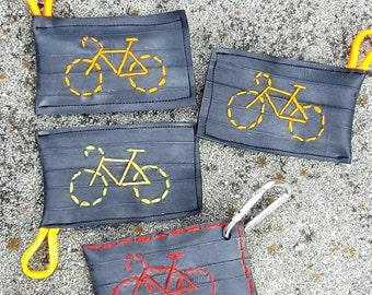 Hand embroidered bike tube key chain.