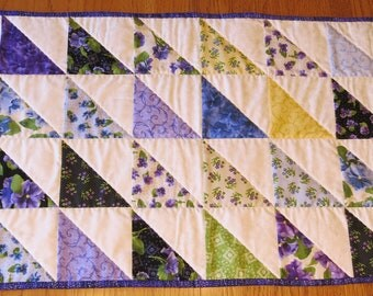 Beautiful spring or summer reversible table runner, quilted table covering, purples and pastel  Handmade runner from 1/2 square triangles