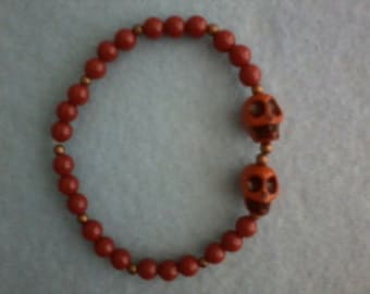 Orange Beaded Bracelet with Skulls