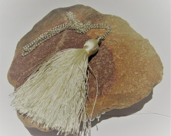 Long tassel necklace with white silk tassel.