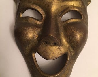 Vintage 60's heavy brass theater mask smiling face wall hanging.