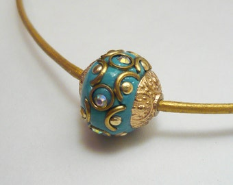 Gold leather choker with decorated bead