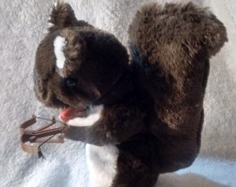 Brown and white furry zombie hunting stuffed squirrel