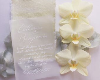 Handwritten wedding invitations on vellum paper