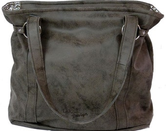 spacious shoulder bag made of synthetic leather