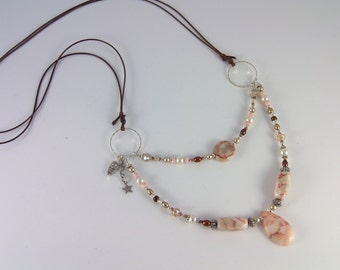 Long double strand adjustable necklace in pinks and neutrals