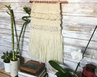 copper and ivory hand woven wall hanging