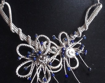 Silver and Gunmetal wire neckpiece with Lapis Lazuli gem accents