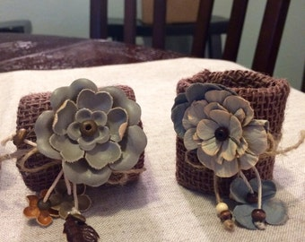 Burlap napkin rings with floral embellishments