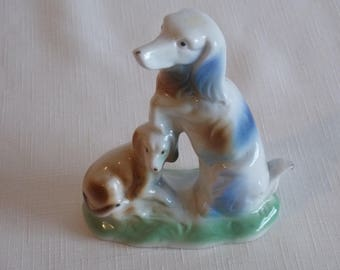 A Special reduction porcelain figurine of Mother and puppy dogs.