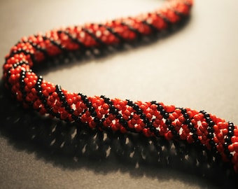 Red and black tubular necklace