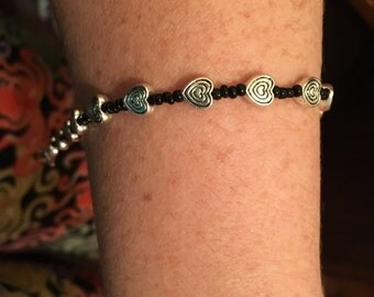 Silver hearts and black bead bracelet