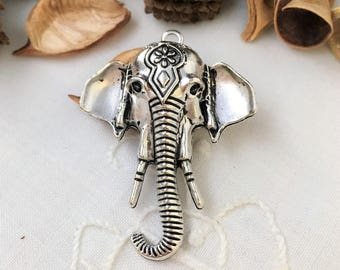 large pendant elephant, aged silver color head, achievement