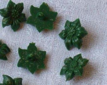 7 dark green plastic shank buttons shaped like flowers