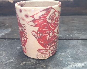 Cup turned stoneware, motive rabbit, oxides under enamel decoration.